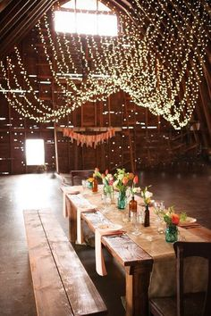 rustic bohemian barn wedding table ideas / http://www.deerpearlflowers.com/barn-wedding-reception-table-decoration/2/