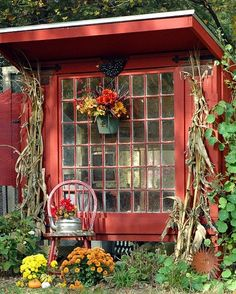 Red shed made from architectural salvage materials or chicken coop