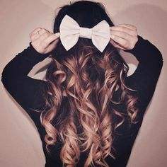The the look of the pink bow with ombre and a black shirt.