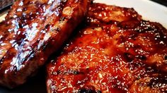 World's Best Honey Garlic Pork Chops A quick and simple grilled pork chop that e. - World's Best Honey Garlic Pork Chops A quick and simple grilled pork chop that everyone ^^ CLICK - World Best Honey, Honey Garlic Pork Chops, Honey Glazed Pork Chops, Chops Recipe, Pork Chops And Beans Recipe, Recipe Directions, Pork Chop Recipes, Sausage Recipes, Meat Recipes
