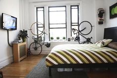 Decorating a small apartment...really need these bike racks now that we don't have a garage