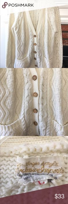 Vintage cream cable knit cardigan sweater large 100% Virgin acrylic  Exclusive Import Women's size large, mens small V-neck cardigan with light brown wood looking buttons Double pockets in front Cream cable knit  Contrasting patterns  Gorgeous, some pilling, reflected in price   Measurements:  Length: 26 in  Small of back to wrist: 31.5 in  Armpit to armpit: 22.5 in  Waist: 19 in   Stretches Vintage Sweaters Cardigans