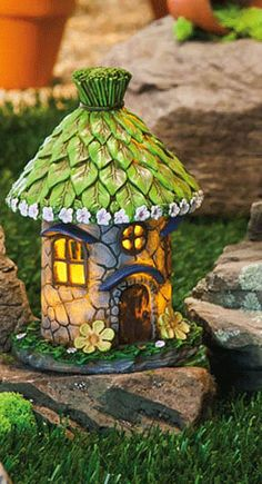http://www.efairies.com/store/pc/Lighted-Fairy-House-with-Green-Leaf-Roof-237p9552.htm Price $24.95