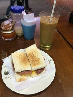"Hong Kong ""Dai Pai Dong"". Traditional Hong Kong Milk Tea and luncheon meat with egg sandwich. Must try!"