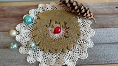 Check out this item in my Etsy shop https://www.etsy.com/listing/188035304/christmas-brass-wreath-trivet-or-wall