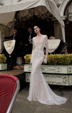 Br 15-15 With long sleeves and a deep scooped back this gown makes for a perfect winter wedding gown #InbalDror