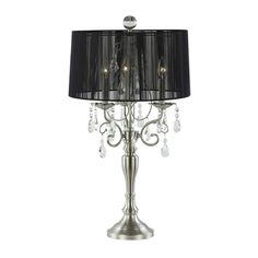 It's a chandelier. It's a lamp. It's a chandelier lamp! Traditional crystals are modernized when paired with the black drum lamp shade.