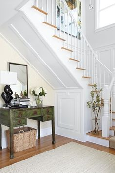 Traditional Entryway with interior wallpaper, Safavieh Carl Antique Green Console Table, Crown molding, High ceiling
