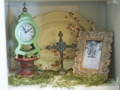 Its that TIME again..Here  on the entertainment =center I have a picture of my baby girl in the francisco frame, with a back drop of the Gail Pittman platter, the Caitlin Cross and to add a little more color and height I added my favorite little clock up on top of the santorini candlestick....some greenery and a few berries for a splach of color and wintery feel...all of these pretties can be found in the shop online section and outlet of my website www.staceyeverett.willowhouse.com