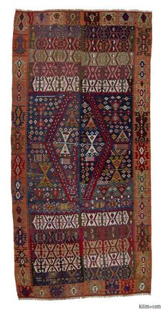 Antique Malatya Kilim Rug with two wings. This vegetable-dyed piece is around 130 years old and in very good condition.