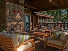 With+a+towering+fireplace+and+a+view+of+Tennessee's+famed+Watts+Bar+Lake,+the+living+room-style+seating+area+provides+a+relaxing+outdoor+getaway.