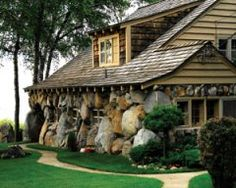 Earl Young's lovely, somewhat eccentric designs for homes/cottages (often called hobbit houses).