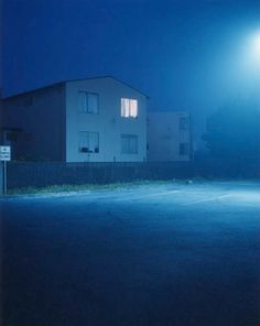 Todd HIDO :: from Homes at Night series. The exterior light source, of course, is salient both for the composition (light and shadow) and for its effect on the color balance of the image. But the interior light, that's the light most critical to the effectiveness of the photograph. The interior light hints at the life inside those isolated houses.