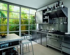 Stainless kitchen with a wall of windows Kitchen Dining, Kitchen Decor, Kitchen Cabinets, Greenhouse Kitchen, Amsterdam Apartment, Stainless Kitchen, Kitchen Gallery, Window Wall, Fun Cooking