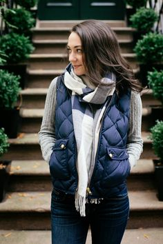 Love the look of a puffy vest and scarf with a simple long sleeve shirt and jeans