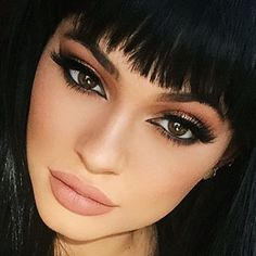 Kylie Jenner had Cleopatra inspired make-up, bronze eyeshadow contoured with black winged eyeliner and matte light brown lipstick