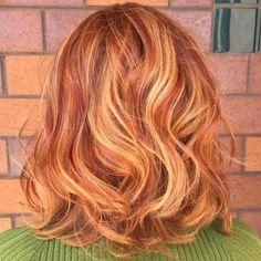 Auburn Lob With Strawberry Blonde Highlights