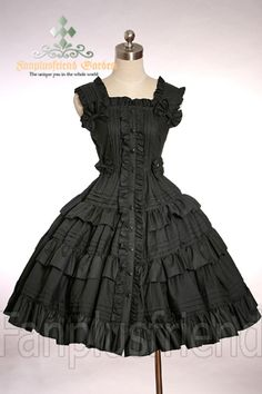 frilly little black dress... love the bit of lolita type styling associated with this. it's feminine and pretty, but a bit dirty.