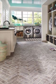 Laundry room /mud room combo - windows and floors -- add a dog door, maybe even dog wash station