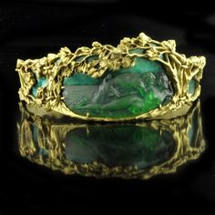 "two lovers in an embrace."" - yellow gold, glass, and enamel Art Nouveau bracelet."