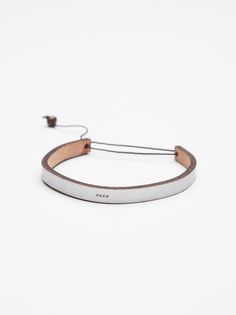 All In A Word Leather Bracelet | Thin adjustable leather bracelet with a simple design. Features a cute and ever-so-subtle engraved design.