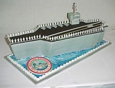 """USS Roosevelt aircraft carrier - did this for a grooms cake, 6 9x13 layers filled and stacked.  the deck was made on foam core, covered with black fondant.  the tower was gumpaste and the airplanes molded chocolate.  then there were 95 1"""" high royal icing piped sailors, hand painted standing all around the deck.  had great fun doing this one.  i actually made 165 sailors just in case!!!!  still have them ready for the next one."""