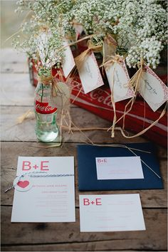 Baby's breath looks wonderfully summery coupled with vintage glass Coca-Cola bottles - cute wedding reception decor.