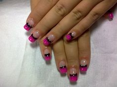 all that you need is a clear bass coat and then make the tip of your nail pink and then make a black line going acrossed the pink on top then take a tooth pick and lightly make the black come down in a little color and then finsh it off with a little coat of silver going on top of the black. :) good luck