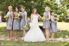 Definitely wear-again material! Lovely grey bridesmaid dresses with fun yellow accents.  // Rustic vintage chic wedding with a dose of Southern hospitality - grey and yellow theme. #Memphis #Wedding Photography by Amy Hutchinson Photography. Venue: Heartwood Hall // Floral: Holliday Flowers // Event designer: Gerald and Joan Design // Invitations: One Little M // Wedding Gown: Sottero and Midgley // Wedding Cake: Cakes by Mom and Me
