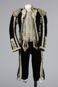 Embroidered rose satin matador cape, late 19th century, couched and embroidered in gold thread and spangled with sequins; together with a black velvet and silver braid matador outfit, comprising blue silk waistcoat, breeches and jacket, Kerry Taylor Auctions Fancy Costumes, Masquerade Ball, Black Velvet, Braids, Auction, Sequins, Textiles, Silk, Cape