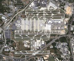 The Hartsfield-Jackson International Airport in Atlanta, GA -- a high aerial view of the massive world's busiest airport, currently built across 4,700-acres, with 2 Main Terminals, 207-gates on 7 Concourses, 5 parallel runways and taxiways galore. ATL also started a new ongoing $6-Billion project in 2016 that will add a new additional 8th Concourse, 6th Runway and End-around Taxiway, along with many other major airport-wide renovations and expansions.