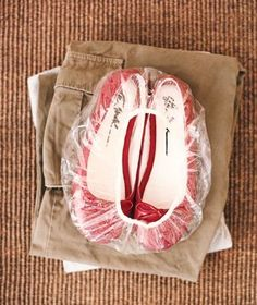 A giveaway shower cap becomes the perfect wrapper for shoes when traveling, preventing them from dirtying clothes packed in your suitcase. | Some of our smartest ways to rethink common items.
