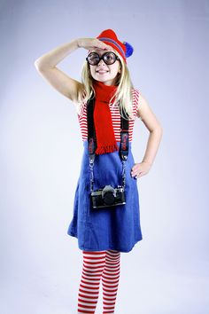 Wenda from Where's Waldo: Check out Goodwill's selection of new Halloween goods and pick out a pair of striped tights and goofy glasses. From our donated goods, find a red and white striped top, denim skirt and stocking hat.