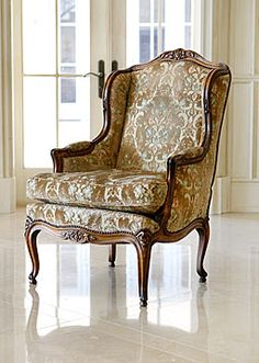 Pair of French Walnut Louis XV-Style Winged Bergeres