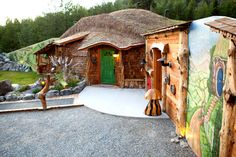 """Location: Trout Creek, Montana  Size: 1,000 square feet    What began as a below-ground vacation home for owner Steve Michaels' family evolved into the Hobbit House of Montana, where Tolkien fans can enjoy the whimsical setting. The Montana """"shire"""" has several hobbit-house-like facades, a tree-stump-shaped troll house and small fairy houses."""