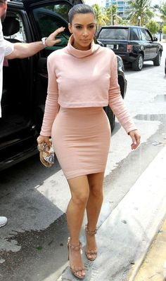 Kim Kardashian's nude bodycon dress. Kim Kardashian-West - Famous and successful, Kim shot to fame after her infamous sextape. Now married to Kanye West (yeezy) and mom to baby daughter North, the selfie queen never fails to provide cute outfits, style, fashion and make up tips. No longer pregnant, Kim is dieting to gain back her hot body.