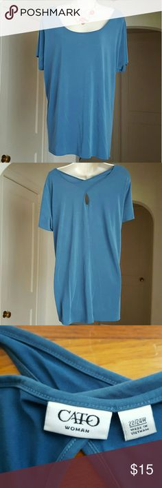 Cato Keyhole Back Tunic Length Top This blue top feels sooo soft! That's the first thing I noticed when I picked it up. It's long enough to wear with leggings. I didn't even know I had this, so it's probably been worn about two times. ?? Size 22/24 Machine wash and dry Cato Tops Tunics