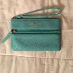 Kate Spade wristlet/clutch Easily fits iPhone 5c or 5s (not sure about a 6 since I don't own one), cards & ID, Chapstick and touch up essentials. Only used a handful of times. No wear or tear or discoloration. kate spade Bags Clutches & Wristlets