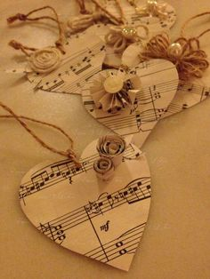 2014 Christmas sheet music heart-shape floating ornaments with paper flowers - Christmas gift tags, Christmas simple crafts Music Christmas Ornaments, Christmas Sheet Music, Paper Ornaments, Christmas Gift Tags, Christmas Crafts, Christmas Decorations, Sheet Music Crafts, Old Sheet Music, Vintage Sheet Music