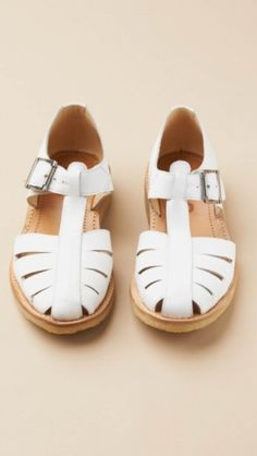 White sandals for bride at reception.