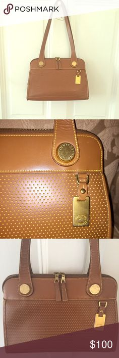 """Dooney & Bourke east west vintage bag 💼 I ❤️ THIS BAG - what an amazing vintage Dooney! Very Good Condition, small tear along zipper seam and minor markings on bottom of bag (see pics) Length, 12 1/4 / Height, 8"""" / Width, 6"""" / Strap Drop, 11"""". The exterior leather is in wonderful condition, with the lighter tan trim showing a very cool distressed look. Interior 1 side has a slip pocket, and the other has a slip pocket plus 2 slots for credit cards or cash. Original manufacturer's sticker…"""
