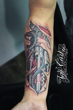 biomechanical arm tattoo