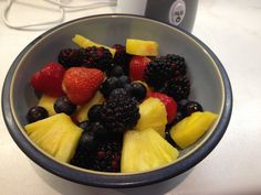 Berries and pineapple heading for the blender.