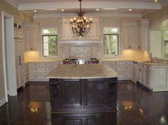 glazed cabinets with dark floors