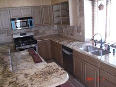 Sienna Bordeaux kitchen countertops and island