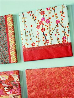 "Create artwork to ""ooh"" and ""aah"" by covering inexpensive 12x12-inch artist canvases with attractive paper patterns. Wrap the canvas like a present with a 1- to 2-inch overhang. Attach the paper to the front with double-stick tape and secure the excess paper to the frame's back with electrical tape. If using multiple paper patterns, hid seams with decorative ribbon."