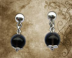 Earring * Model: Black * Material: 950 Silver law, natural semiprecious stones N ° 10 Obsidian transparent. * Stock: 01 pair Shop Now $15.00