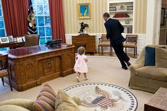 This little girl, the daughter of a White House staffer, keeps the president on his toes as they run circles around his desk in the oval office. The OVAL office. Can you imagine how many times around and around and around you'd have to go?