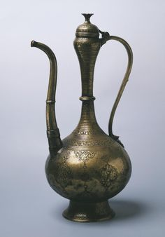 Name:  Ewer  Place of creation: Iran  Date: Early 17th century  Material: bronze (brass)  Technique:  cast and engraved  Dimension:  h. 49,3 cm