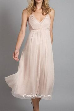 Tea length blush chiffon bridesmaid dress features deep v neck with layers in front, pleated bodice has ruched details.